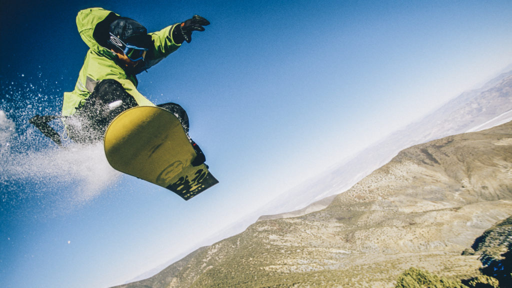 DEATH VALLEY, CA Pro-snowboarder John Cartwright dropping off a cliff on Telescope PeakImages. (Photo by Olivier Renck/Cavan Images.)